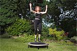 Mature woman jumping on trampoline Stock Photo - Premium Royalty-Free, Artist: Jon Arnold Images, Code: 649-02423679