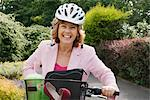 Woman wearing helmet on bicycle Stock Photo - Premium Royalty-Free, Artist: Arcaid, Code: 649-02423683