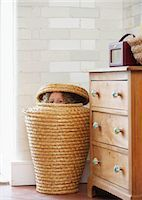 Child hiding in laundry basket Stock Photo - Premium Royalty-Freenull, Code: 649-02424009