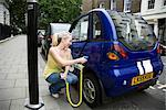 Young woman charging electric car Stock Photo - Premium Royalty-Free, Artist: Mike Randolph, Code: 649-02424171