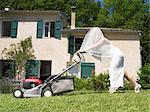 Bride mowing lawn Stock Photo - Premium Royalty-Free, Artist: Cusp and Flirt, Code: 649-02424535