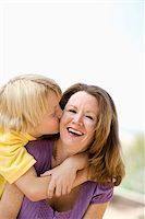 preteen kissing - Mother and son embracing Stock Photo - Premium Royalty-Freenull, Code: 621-02425755