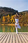 Woman Practicing Yoga on Dock, Fuschlsee, Salzkammergut, Salzburg, Austria    Stock Photo - Premium Rights-Managed, Artist: Bryan Reinhart, Code: 700-02428630