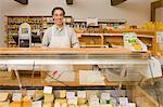 Grocer by Cheese Display    Stock Photo - Premium Rights-Managed, Artist: Lothar Wels, Code: 700-02428689