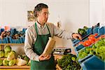 Grocer with Vegetables    Stock Photo - Premium Rights-Managed, Artist: Lothar Wels, Code: 700-02428699