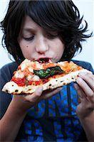 Boy Eating Pizza    Stock Photo - Premium Royalty-Freenull, Code: 600-02429175