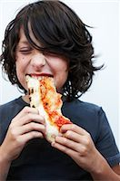 Boy Eating Pizza    Stock Photo - Premium Royalty-Freenull, Code: 600-02429176