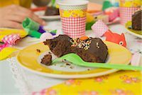 Close-up of Partially Eaten Birthday Cake    Stock Photo - Premium Royalty-Freenull, Code: 600-02461251