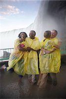 People Having Fun in the Mist Under Niagara Falls, Ontario, Canada    Stock Photo - Premium Rights-Managednull, Code: 700-02461625