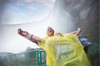 Couple Having Fun in the Mist Under Niagara Falls, Ontario, Canada    Stock Photo - Premium Rights-Managednull, Code: 700-02461629