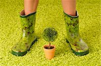 Woman in Rubber Boots with Potted Plant    Stock Photo - Premium Royalty-Freenull, Code: 600-02519117
