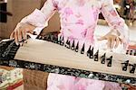Playing the Slide Zither, Hoian, Vietnam    Stock Photo - Premium Rights-Managed, Artist: Brian Pieters, Code: 700-02593808