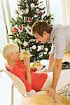 Couple Exchanging Gifts on Christmas Morning    Stock Photo - Premium Rights-Managed, Artist: Raoul Minsart, Code: 700-02594331