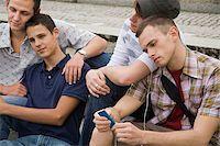 Friends sitting on steps Stock Photo - Premium Royalty-Freenull, Code: 614-02613430