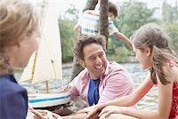 pre-teen boy models - Family having fun near lake Stock Photo - Premium Royalty-Freenull, Code: 635-02614298