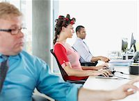 Businesswoman working and wearing curlers at desk Stock Photo - Premium Royalty-Freenull, Code: 635-02614447