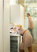 Businesswoman photocopying her head Stock Photo - Premium Royalty-Freenull, Code: 635-02614520