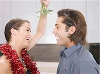 Couple kissing under mistletoe Stock Photo - Premium Royalty-Freenull, Code: 635-02614692