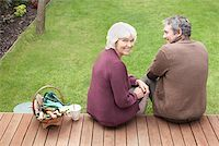 Couple sitting on backyard deck Stock Photo - Premium Royalty-Freenull, Code: 635-02614759