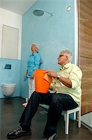 Senior couple cleaning bathroom Stock Photo - Premium Royalty-Freenull, Code: 628-02615240