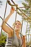 Young woman at obstacle course climbing a cargo net    Stock Photo - Premium Rights-Managed, Artist: ableimages, Code: 822-02620779