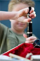 Close up of a boy hands putting together a clarinet    Stock Photo - Premium Rights-Managednull, Code: 822-02621489