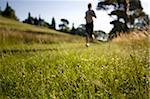 Girl jogging in countryside Stock Photo - Premium Royalty-Free, Artist: Cultura RM, Code: 622-02621570