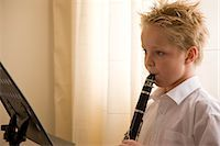 Boy standing in front of a music stand playing the clarinet    Stock Photo - Premium Rights-Managednull, Code: 822-02621501