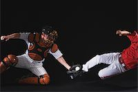 professional baseball game - Baseball player sliding into a base Stock Photo - Premium Royalty-Freenull, Code: 622-02621707