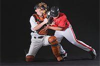 professional baseball game - Baseball player sliding into a base Stock Photo - Premium Royalty-Freenull, Code: 622-02621725