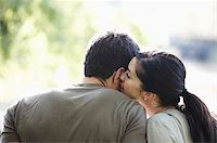 Woman kissing mans neck Stock Photo - Premium Royalty-Freenull, Code: 621-02622655
