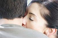 Woman kissing mans neck Stock Photo - Premium Royalty-Freenull, Code: 621-02622656