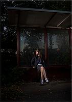 Girl Waiting at Bus Stop at Night    Stock Photo - Premium Rights-Managednull, Code: 700-02633615