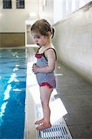 Nervous Little Girl Standing on Edge of Swimming Pool    Stock Photo - Premium Rights-Managednull, Code: 700-02633620