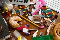 An office desk cluttered with candy and sweets Stock Photo - Premium Royalty-Freenull, Code: 653-02634148