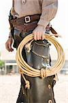 A cowboy holding a rope Stock Photo - Premium Royalty-Free, Artist: Sarah Murray, Code: 653-02634402