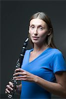 A young woman holding a clarinet Stock Photo - Premium Royalty-Freenull, Code: 653-02634492