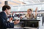 Upset businesswoman checking in at airport ticket counter Stock Photo - Premium Royalty-Free, Artist: Oriental Touch, Code: 604-02636319