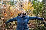 Woman Throwing Autumn Leaves    Stock Photo - Premium Rights-Managed, Artist: Pierre Arsenault, Code: 700-02637171
