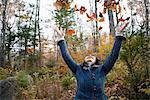 Woman Throwing Autumn Leaves    Stock Photo - Premium Rights-Managed, Artist: Pierre Arsenault, Code: 700-02637173