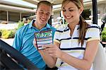 Couple with Score Card in Golf Cart, Burlington, Ontario, Canada