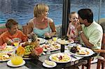 Family Eating Lunch Outdoors    Stock Photo - Premium Rights-Managed, Artist: Harald Vorsteher, Code: 700-02638161