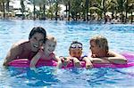 Family Having Fun in Swimming Pool    Stock Photo - Premium Rights-Managed, Artist: Harald Vorsteher, Code: 700-02638163