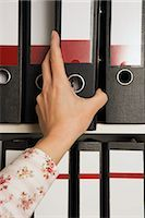 Businesswoman Reaching for File Folder    Stock Photo - Premium Rights-Managednull, Code: 700-02638192