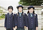 Elementary school students standing in front of school gate Stock Photo - Premium Royalty-Freenull, Code: 670-02642678