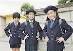 Elementary school students standing in front of school gate Stock Photo - Premium Royalty-Freenull, Code: 670-02642679