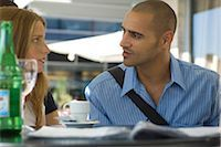student fighting - Man and woman sitting in outdoor cafe, having serious conversation Stock Photo - Premium Royalty-Freenull, Code: 632-02644979