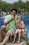 Father and Daughter Eating Hot Dogs    Stock Photo - Premium Rights-Managed, Artist: Harald Vorsteher, Code: 700-02645879