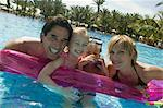 Family Floating on Air Mattress    Stock Photo - Premium Rights-Managed, Artist: Harald Vorsteher, Code: 700-02645894