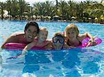 Family Floating on Air Mattress    Stock Photo - Premium Rights-Managed, Artist: Harald Vorsteher, Code: 700-02645916
